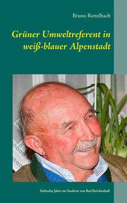 Grüner Umweltreferent in weiß-blauer Alpenstadt
